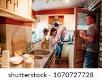 a whole family are busy in the... | Shutterstock . vector #1070727728