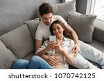 caucasian couple man and woman... | Shutterstock . vector #1070742125