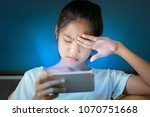 teenage girl  hurt her eyes... | Shutterstock . vector #1070751668