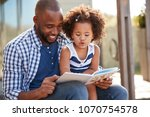 young black father and daughter ... | Shutterstock . vector #1070754578