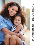mixed race mother and young... | Shutterstock . vector #1070755142