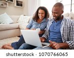 young black couple using laptop ... | Shutterstock . vector #1070766065