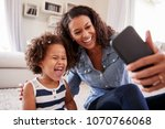 young mother and toddler... | Shutterstock . vector #1070766068