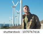 man's portrait outdoor against... | Shutterstock . vector #1070767616