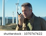 man talking with portable radio ... | Shutterstock . vector #1070767622