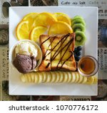 honey toast with tropical fruit ... | Shutterstock . vector #1070776172