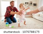 toddler girl walking from dad... | Shutterstock . vector #1070788175