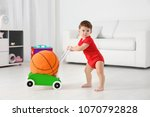 Cute Baby Playing With Toy...