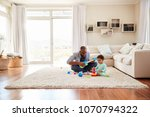 black father and toddler son... | Shutterstock . vector #1070794322