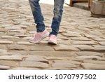 legs of a teenager. walk around ... | Shutterstock . vector #1070797502