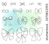 set of ink drawn bows on a...   Shutterstock . vector #1070812592