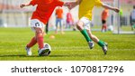 a group of young boys kicking... | Shutterstock . vector #1070817296
