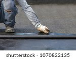 asia worker installing tar foil ... | Shutterstock . vector #1070822135