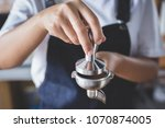 lady barista holding a coffee... | Shutterstock . vector #1070874005
