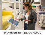 woman with phone configuring...   Shutterstock . vector #1070876972