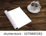 open mock up magazine and a cup ... | Shutterstock . vector #1070885282