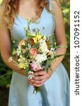 bridesmaid holding bouquet of... | Shutterstock . vector #107091152