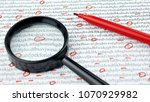 Small photo of Cipher encryption code or data encrypt with magnifying glass and red pen