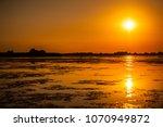 sunset in the danube delta... | Shutterstock . vector #1070949872