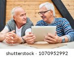 portrait of two cheerful senior ... | Shutterstock . vector #1070952992