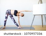 young woman doing stretching... | Shutterstock . vector #1070957336