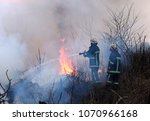 firefighters spray water to... | Shutterstock . vector #1070966168