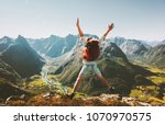 happy man traveler jumping with ... | Shutterstock . vector #1070970575