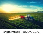 aerial view of farming tractor... | Shutterstock . vector #1070972672