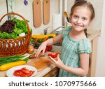 child girl cooking in home...   Shutterstock . vector #1070975666