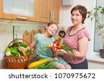 mother and daughter cooking....   Shutterstock . vector #1070975672