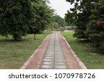 a walk pathway in a park with... | Shutterstock . vector #1070978726