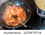 cooking prawns and tomatoes in...   Shutterstock . vector #1070979716