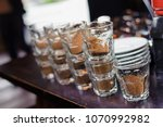 tasting coffee in glass glasses | Shutterstock . vector #1070992982
