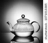 glass teapot with boiling water ... | Shutterstock . vector #1071013385