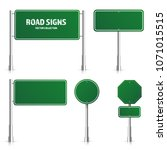 road green traffic sign. blank... | Shutterstock .eps vector #1071015515