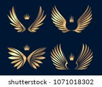 set of four pairs of gold wings ... | Shutterstock .eps vector #1071018302