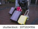 people carrying baggage.... | Shutterstock . vector #1071024506