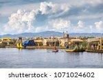 uros floating island  lake... | Shutterstock . vector #1071024602