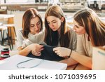 three women look at t shirt and ... | Shutterstock . vector #1071039695