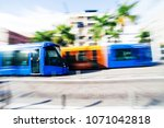 colorful modern trams are... | Shutterstock . vector #1071042818