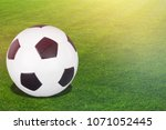 football ball on a grass | Shutterstock . vector #1071052445