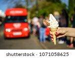 99 flek ice cream on hand in... | Shutterstock . vector #1071058625