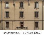 aged vintage building facade... | Shutterstock . vector #1071061262