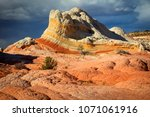 colorful sunset at white pocket ... | Shutterstock . vector #1071061916
