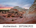 colorful sunset at white pocket ... | Shutterstock . vector #1071061922