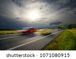 motion blurred cars driving on... | Shutterstock . vector #1071080915
