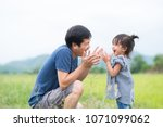 asian father and daughter are... | Shutterstock . vector #1071099062