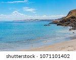 sea coastline with sandy beach... | Shutterstock . vector #1071101402