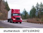 red big rig day cab semi truck... | Shutterstock . vector #1071104342