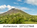 the arenal volcano surrounded... | Shutterstock . vector #1071127868
